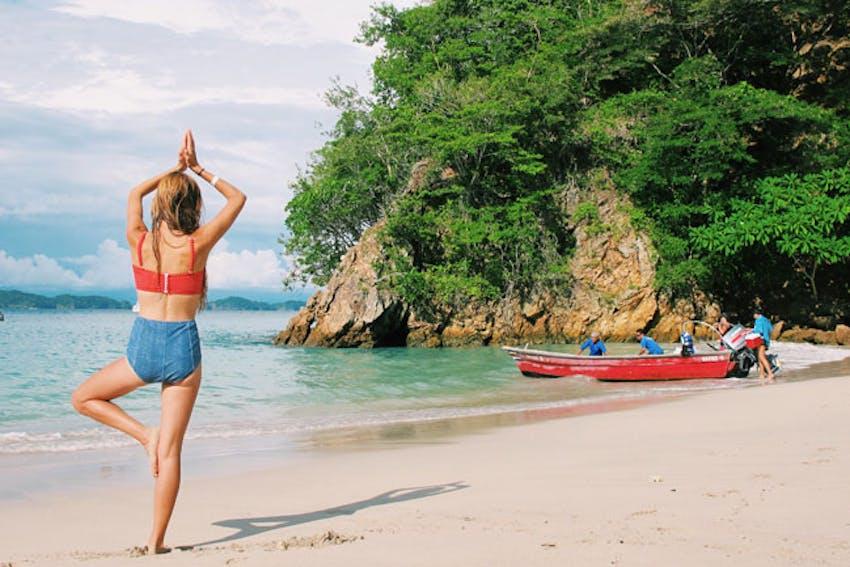 Hannah Pitts on a beach during an IVHQ weekend