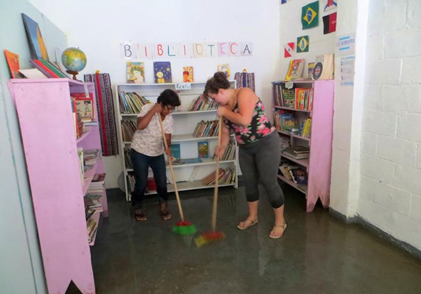 Cleaning the library in Brazil with IVHQ as a volunteer