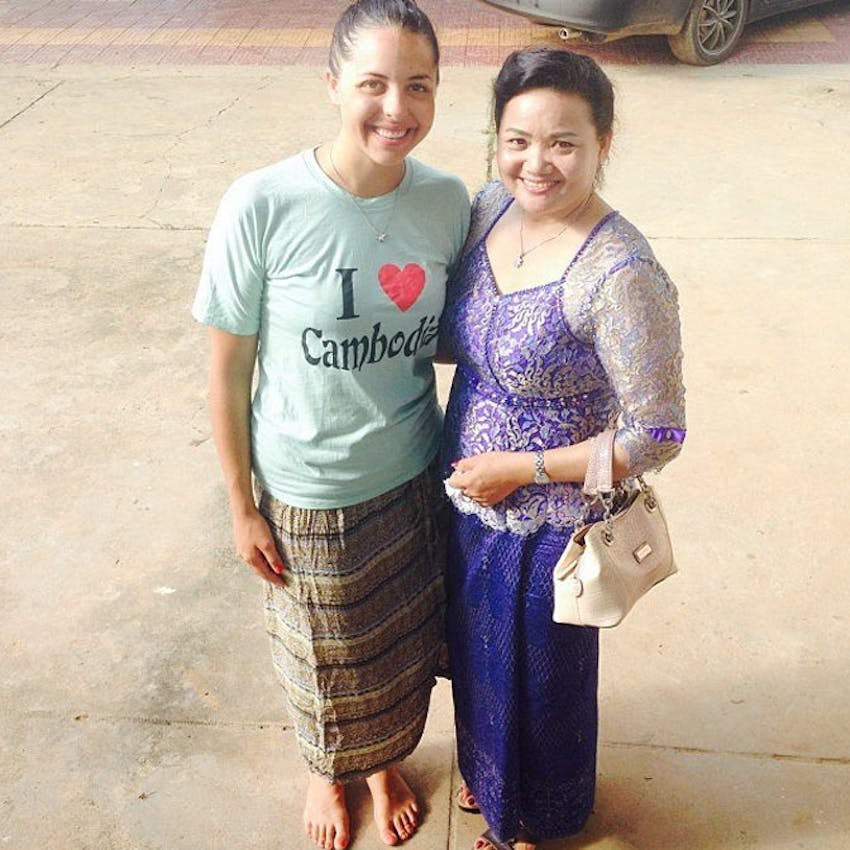 A volunteer host mother in Cambodia with IVHQ