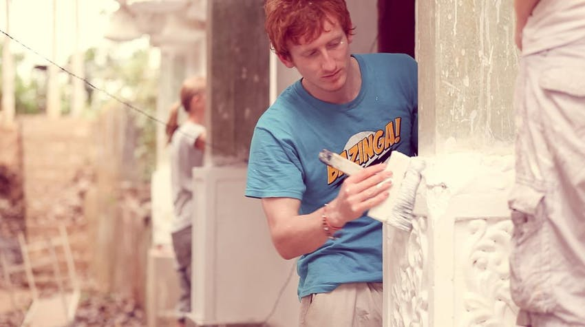 A volunteer works on a temple renovation project in Sri Lanka with IVHQ