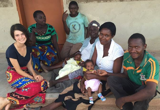 An IVHQ volunteer in Zambia and her family