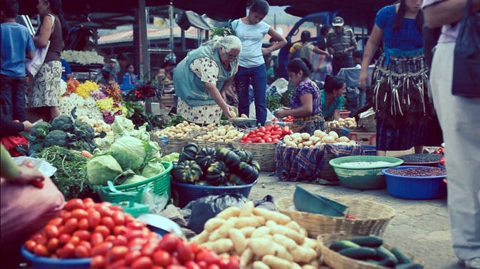 IVHQ scholarship winner Armando visits a local market in Guatemala
