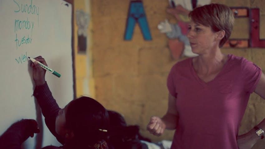 Senior IVHQ volunteers teach english volunteer abroad with International Volunteer HQ