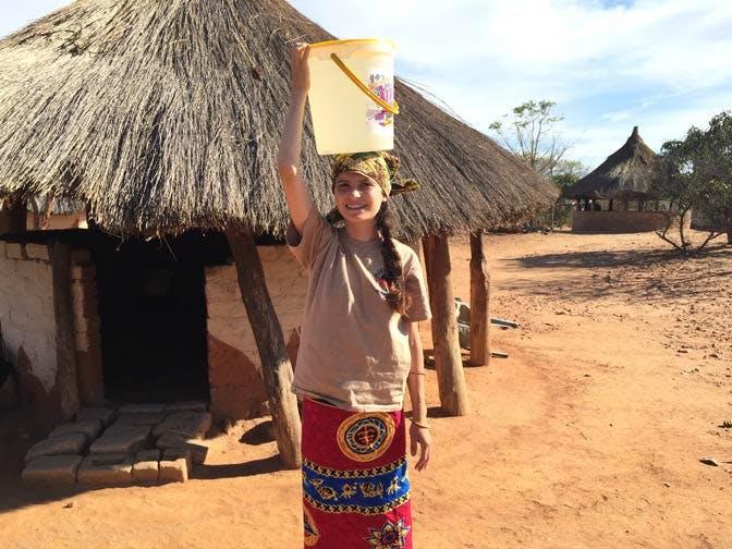 Gathering water as an IVHQ volunteer in Zambia