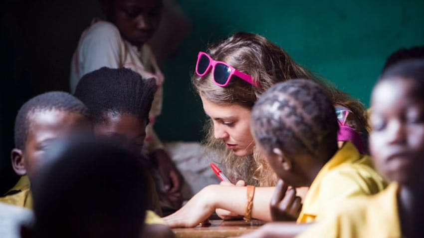 Teenage volunteer in Zambia with IVHQ