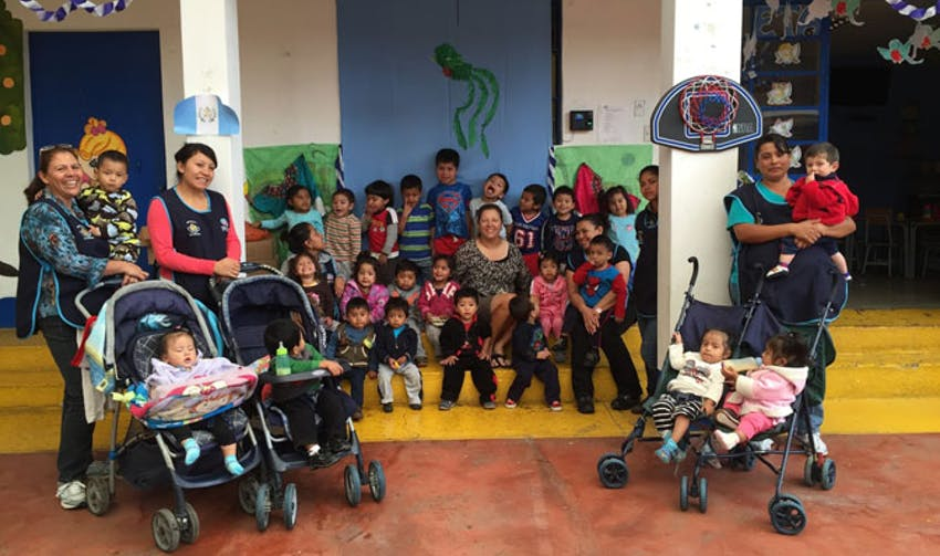 IVHQ volunteer, Sue, with the local childcare placement in Guatemala
