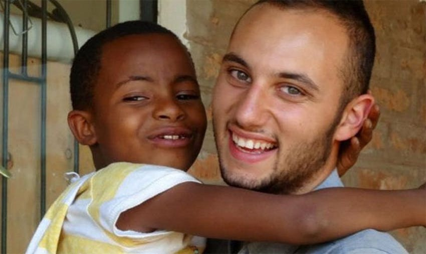 IVHQ volunteer Zac with a local child in Tanzania