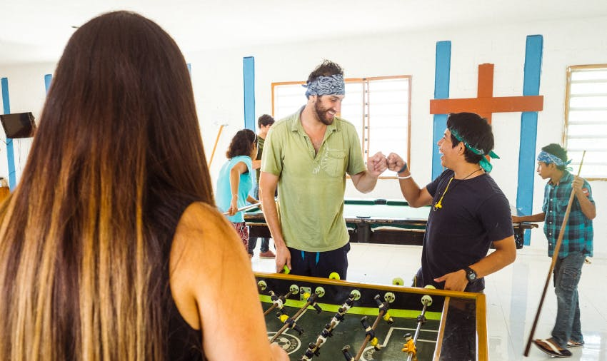 IVHQ Mexico volunteer paying fooseball with locals