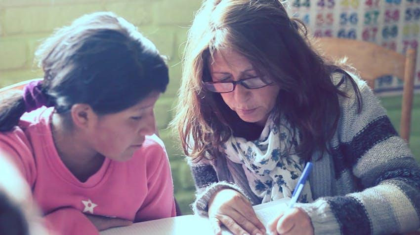 Volunteer parent teaching in Peru, Cusco with IVHQ