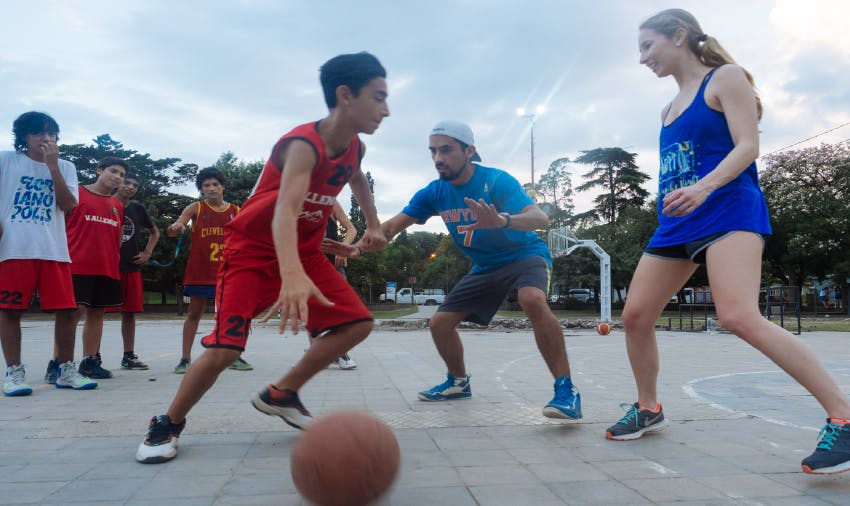 IVHQ volunteer playing basketball with children