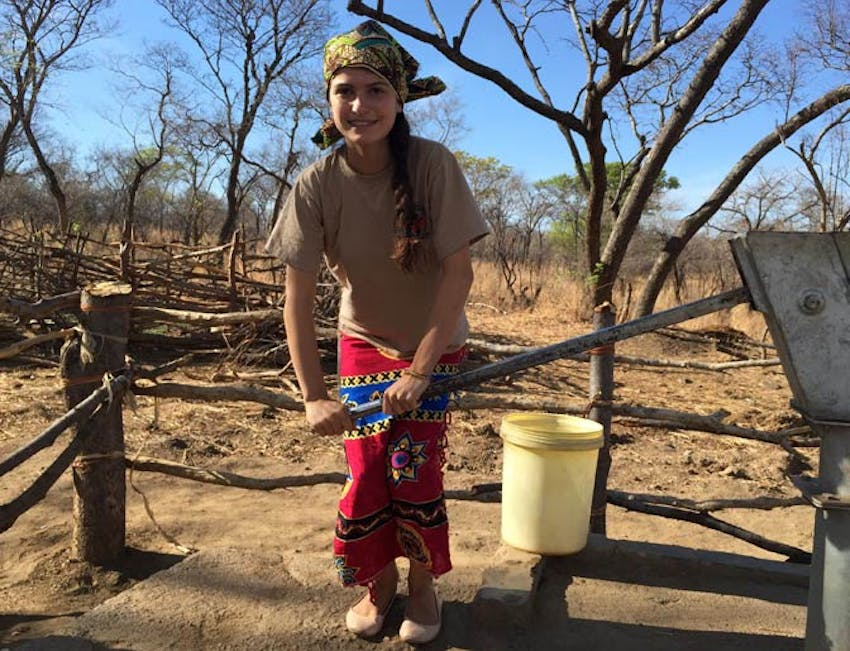 An IVHQ volunteer collecting water in a Zambian Village