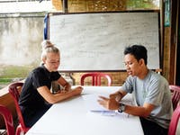 Volunteer teacher preparing for a lesson in Ubud, Bali with IVHQ