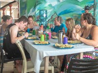 Volunteers enjoying a meal in Belize with IVHQ