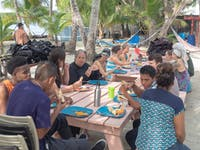 Volunteers eating a meal in Belize with IVHQ