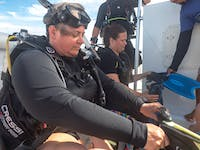 Volunteers prepare for a dive in Belize with IVHQ