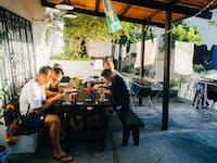 IVHQ volunteers enjoy a meal in Brazil outside