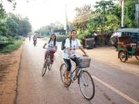 IVHQ volunteers biking to their volunteer project in Cambodia