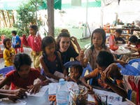 IVHQ volunteering with children in Cambodia with IVHQ
