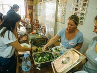 IVHQ Volunteers serve lunch in Cambodia