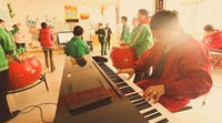 Assisting with music lessons in China