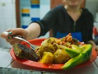 Volunteer feeding the homeless in Bogota with IVHQ