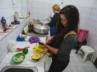 Feeding the homeless volunteer in Bogota with IVHQ
