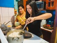 IVHQ Childcare volunteer cooking in Costa Rica