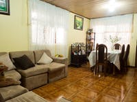IVHQ volunteer house living room in San Jose, Costa Rica