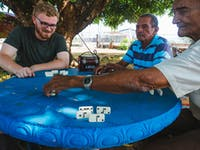 IVHQ Special Needs volunteer in Costa Rica playing dominos