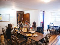IVHQ volunteers dining in Ecuador