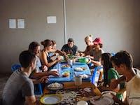 Volunteers eating dinner in Ghana with IVHQ