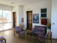 IVHQ volunteer living room area in Greece
