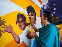 Painting Childcare volunteer in Delhi India with IVHQ