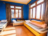 Volunteer house bedroom in Dharamsala, India with IVHQ