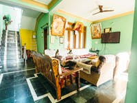 Volunteer living room in Dharamsala, India with IVHQ