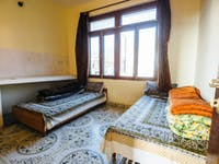 Volunteer bedroom in Dharamsala, India with IVHQ