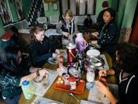 Volunteers eating dinner in Dharamsala, India with IVHQ