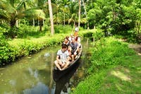 Volunteers Exploring Kerala by Canoe