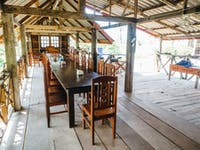 Volunteer house dining room in Laos with IVHQ