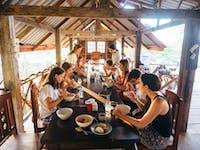 IVHQ volunteers enjoy a meal in Laos