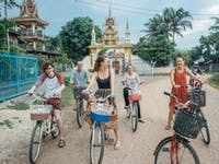 A group of IVHQ volunteers explore Vientiane by bike in Laos during the weekend
