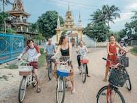 A group of IVHQ volunteers explore Vientiane by bike in Laos during the weekend