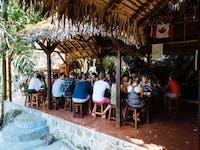 Volunteers eating meal in Madagascar with IVHQ