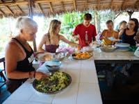 Volunteers serving dinner in Madagascar with IVHQ