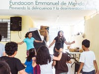 Childcare volunteers in Mexico dancing
