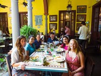 Volunteers dining in Merida with IVHQ in Mexico