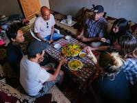 Atlas Mountains volunteers dining with IVHQ