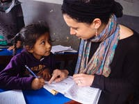 IVHQ Childcare volunteer teaching English in Nepal with IVHQ