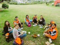 Volunteers eating lunch at volunteer project in New Zealand with IVHQ