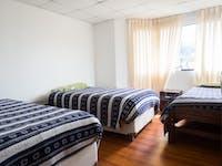 Volunteer bedroom in Cusco, Peru with IVHQ